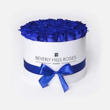 Blue roses in 'Lagoon' – Medium white box