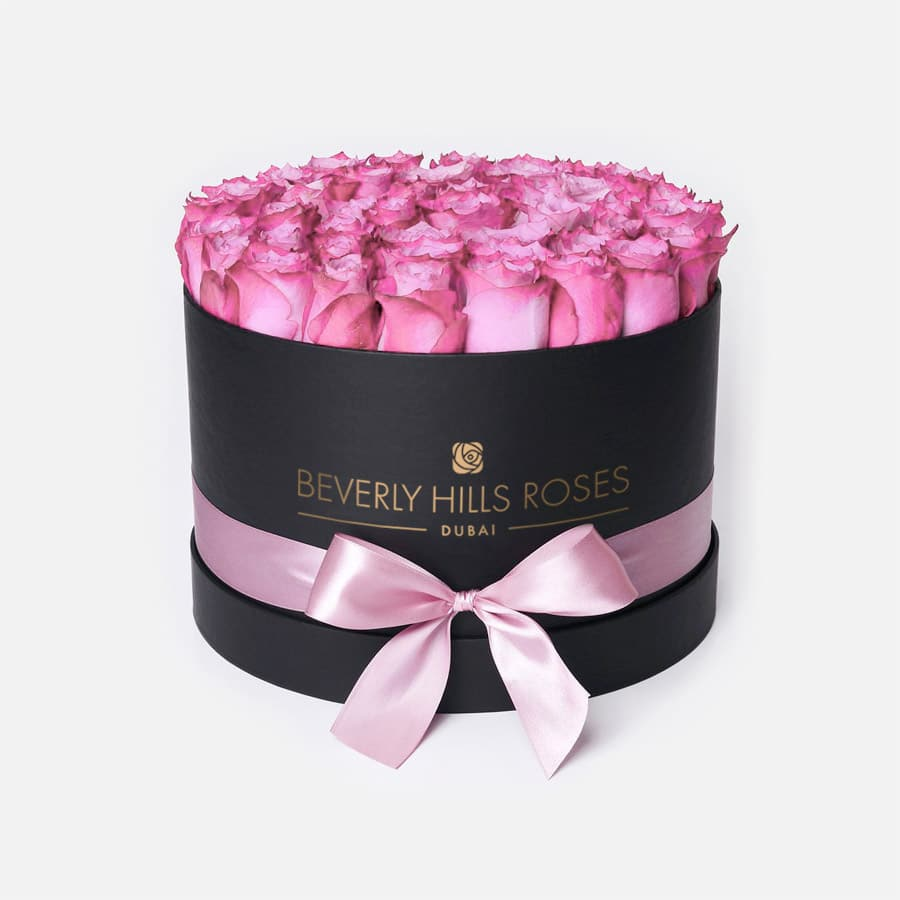 bouquet of roses in a box candy in medium black box. Black Bedroom Furniture Sets. Home Design Ideas