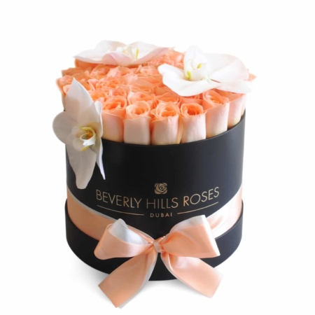 Peach roses with orchids in ' Peach Royal' – Medium black box