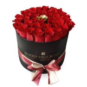 Red roses with a Gold rose in 'Golden Eye'