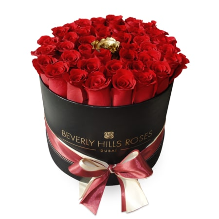 Red roses with a Gold rose in 'Golden Eye' – Medium black box