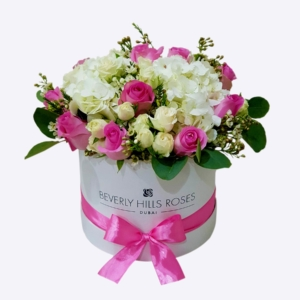 Pink rose and white hydrangea bouquet in a box