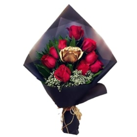 Red roses with a Gold rose in 'Gold Love'