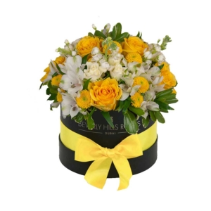 Yellow roses and flowers in Round Box